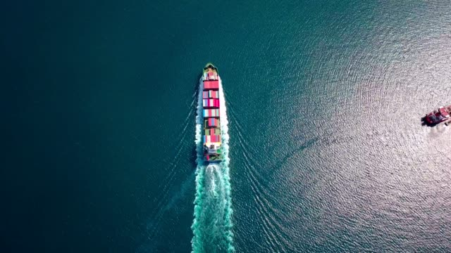 Aerial footage of ultra large container ship at sea, top down view