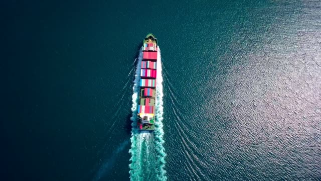 aerial footage of ultra large container ship at sea, top down view - nave mercantile video stock e b–roll