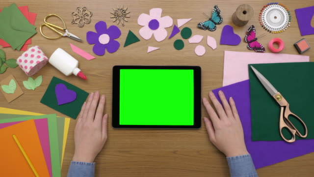 Aerial Footage Of Woman Using Digital Tablet By Art Equipment video