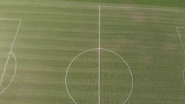 Aerial footage over a playing field in the UK video