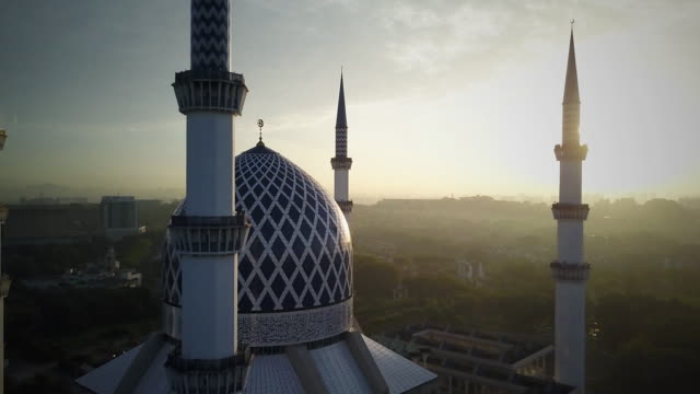 aerial footage - sunrise at a mosque. - malaysia video stock e b–roll