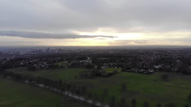 Aerial footage taken over a park near a town video