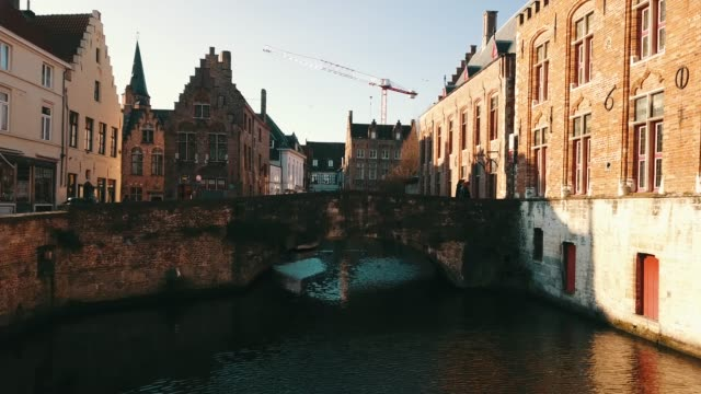 4k aerial footage under the medieval city center of brugge in the summer day - bruges video stock e b–roll