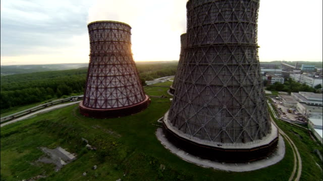 Aerial Footage Wide Angle Nuclear Cooling Towers Against Sunrise video