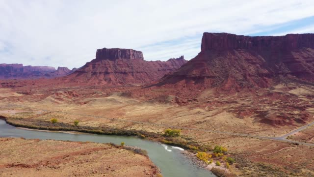 Aerial Forward Over The Colorado River Among Canyon With Monuments Of Red Rock
