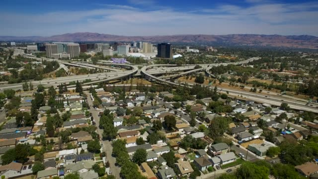 aerial freeway interchange in san jose - silicon valley - california video stock e b–roll