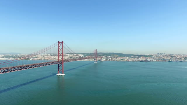 Aerial from the 25 Abril bridge and the river Tejo in Lisbon Portugal Aerial from the 25 Abril bridge and the river Tejo in Lisbon Portugal ponte 25 de abril stock videos & royalty-free footage