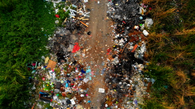 vídeos de stock e filmes b-roll de aerial: garbage dump on the outskirts of the forest - poluição