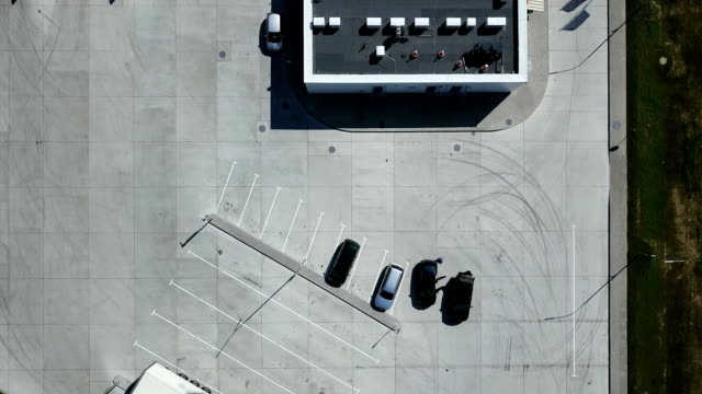 Aerial: Gas station. Cars on the parking near the store at the petrol station. video