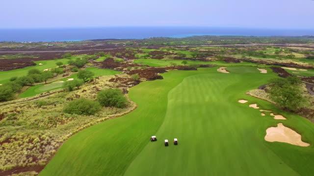 Aerial - Hawaii Golfers A gorgeous eighteen holes in Kona, Hawaii big island hawaii islands stock videos & royalty-free footage