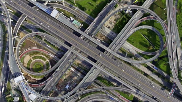 Aerial highway junction. Busy highway from aerial view. video