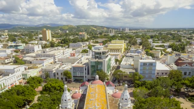 Aerial hyper lapse around town of Ponce in Puerto Rico Daytime Aerial hyper lapse around town center in Ponce, Puerto Rico puerto rico stock videos & royalty-free footage