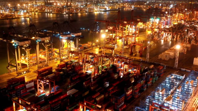 Aerial Hyper Lapse of Container Ship Terminal at Night, Hong Kong