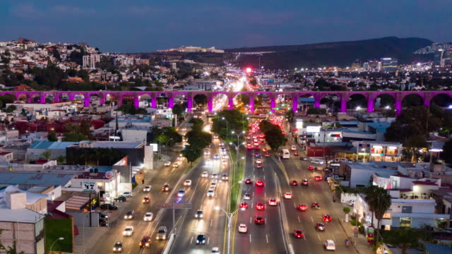 Aerial Hyper lapse of Queretaro Skyline Aerial Hyper lapse of the traffic passing under Queretaro aqueduct traffic time lapse stock videos & royalty-free footage