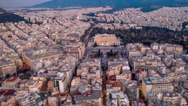 Aerial hyperlapse of Athens, Greece, Syntagma Square and Acropolis, people, cars, clouds Aerial hyperlapse of Athens, Greece, Syntagma Square and Acropolis, people, cars, clouds athens greece stock videos & royalty-free footage