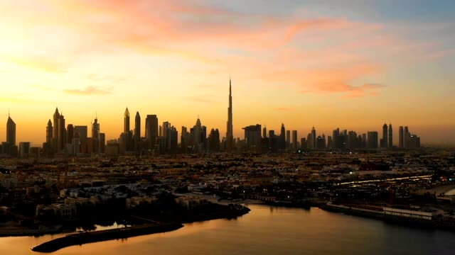 aerial hyperlapse of dubai skyscrapers during scenic sunset, dubai, u.a.e. - dubai architecture stock videos & royalty-free footage