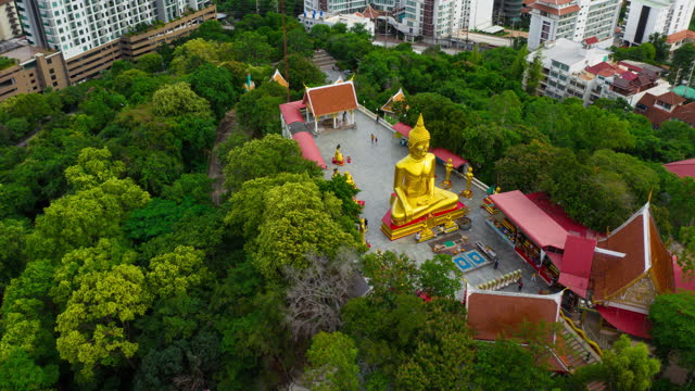 Aerial Hyperlapse of Golden Big Buddha 4K Aerial Hyperlapse or Dronelapse of Golden Big Buddha on the top of mountain in Pattaya city, Chonburi Province, Thailand pattaya stock videos & royalty-free footage