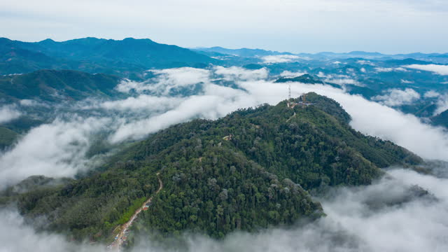 Aerial hyperlapse or time lapse of fog in valley