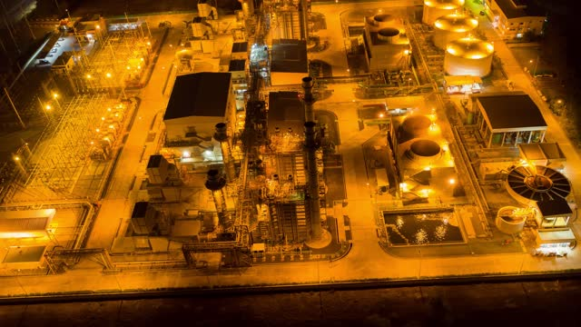 Aerial Hyperlapse Time lapse of oil refinery terminal is industrial facility for storage of oil and petrochemical