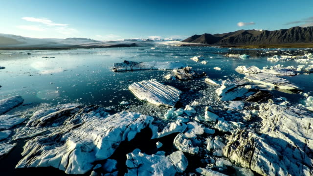 Aerial : Icebergs in Jokulsarlon Lagoon - Iceland video