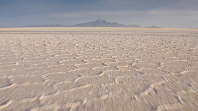 Aerial Incahuasi Island on Uyuni salar. South of Bolivia Aerial sun rise shot at Incahuasi Island on Uyuni salar dessert. South of Bolivia. salt flat stock videos & royalty-free footage