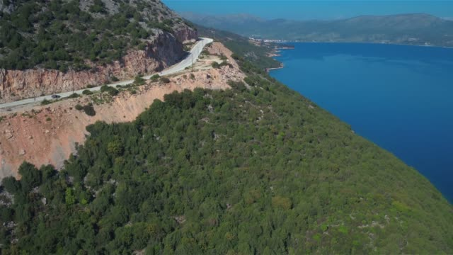 Aerial - Ionian Sea - revealing the town of Astakos by the sea video