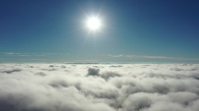 Aerial landscape above the clouds with beauty sunlight and blue sky. Great landscape.