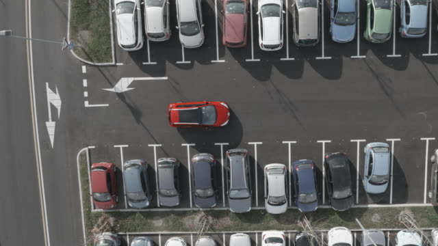 4K Aerial: Lift above, Car Find Last Free Parking Space video