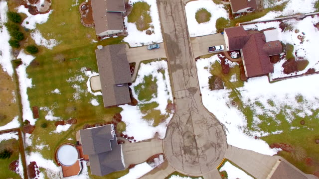 Aerial looking straight down on middle-class neighborhoods, some snow video
