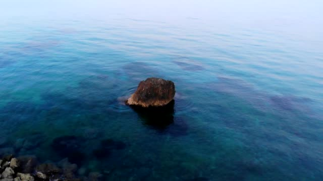 Aerial loop around a rock in the Cirica Bay