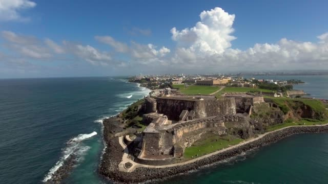 Aerial low altitude shot from the ocean of El Morro in Old San Juan, Puerto Rico Daytime low altitude aerial shot from ocean of Castillo San Cristobal del Morro in Old San Juan, Puerto Rico puerto rico stock videos & royalty-free footage