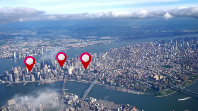 Aerial Manhattan Real Estate GPS Markers Simulated GPS waypoints appear over an aerial view of Manhattan. pointing stock videos & royalty-free footage