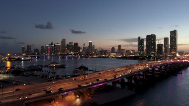 Aerial Miami Downtown at dusk from the Venetian causeway Aerial view of Miami Downtown skyline  and  the MacArthur causeway at dusk shot from the Venetian causeway south stock videos & royalty-free footage