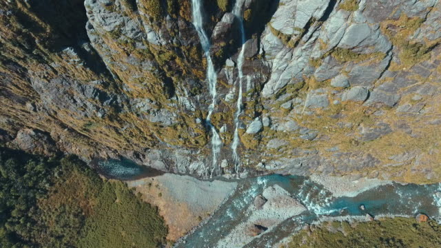 aerial milford sound waterfall - cliffs stock videos & royalty-free footage