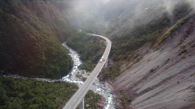 vídeos de stock e filmes b-roll de aerial mist scenery view road pass - vídeos de barragem portugal