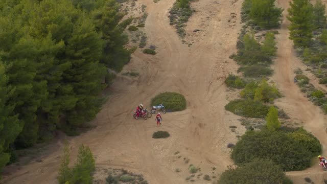 Aerial, motocross sports and practice at the forest, motocross athletes are preparing for practice in the forest video