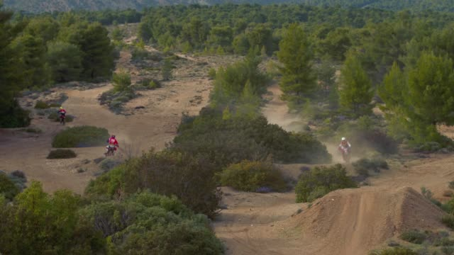 Aerial, motocross sports and practice at the forest, motocross athletes are practising in the forest video