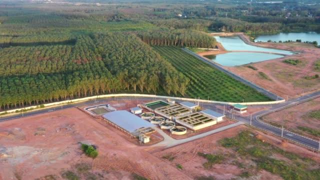 4k aerial movie of sewage treatment plant - биомасса возобновляемая энергия стоковые видео и кадры b-roll
