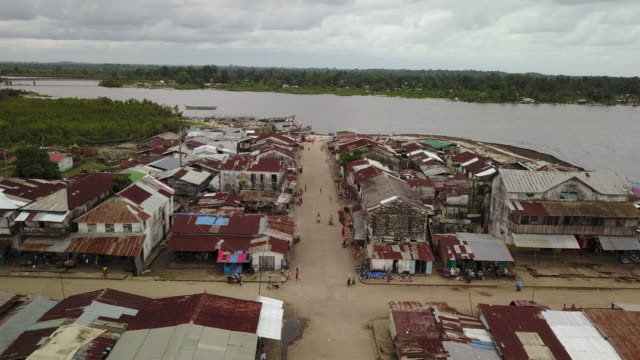 aerial moving down poverty and war stricken third world country street - liberia video stock e b–roll