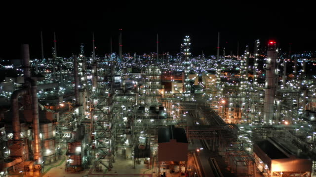 Aerial moving right of oil refinery industry real time