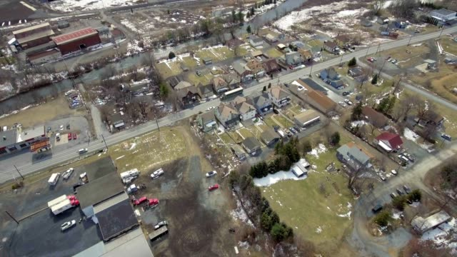 Aerial neighborhood by recyling plant video