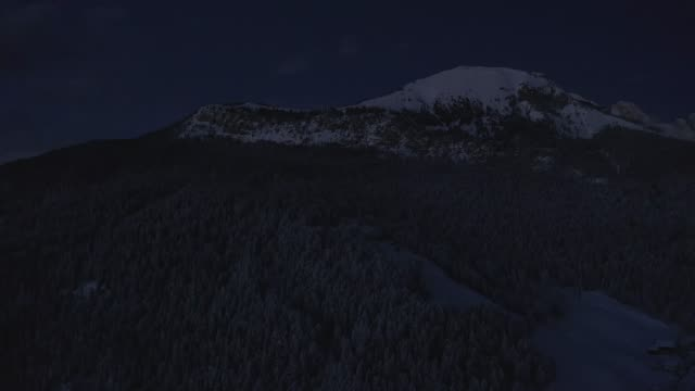 Aerial night view of the Val Gardena ski resort mountain village in Dolomites.