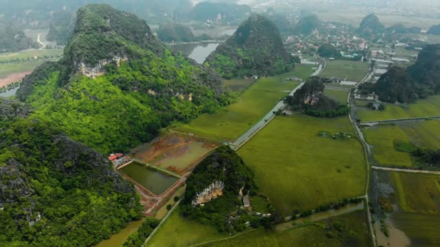 Aerial: North Vietnam karst landscape, drone view of Ninh Binh region