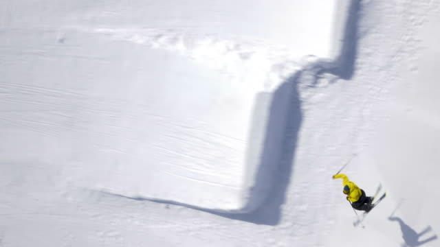 Aerial of a freestyle skier performing a jump with a rotation video
