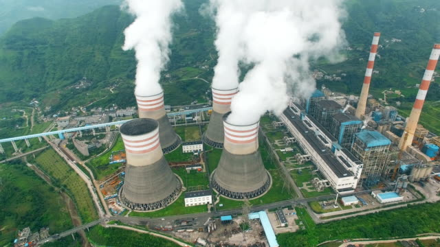 aerial of a power station,guizhou,china. - centrale termoelettrica video stock e b–roll