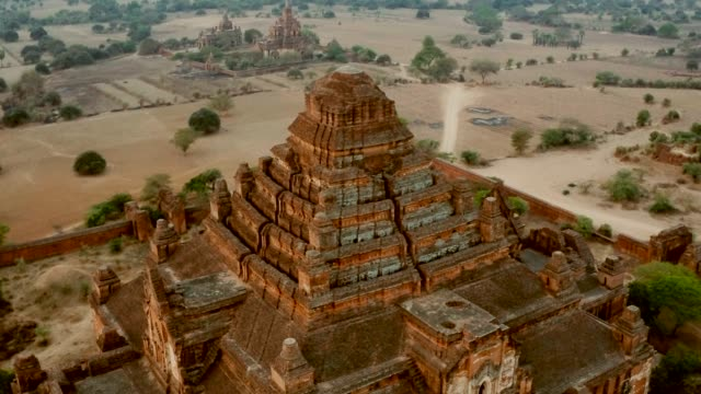 Aerial of Ancient Temple Flying through a valley of temples in Old Bagan, Myanmar bagan stock videos & royalty-free footage
