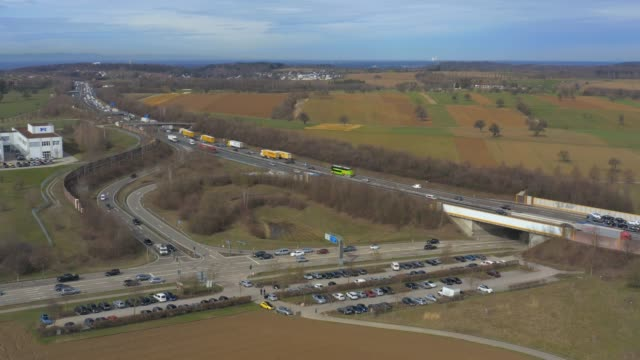 Aerial of Autobahn A8 close to Karlsruhe Aerial of Autobahn A8 close to Karlsruhe with traffic jam and highway exit autobahn stock videos & royalty-free footage