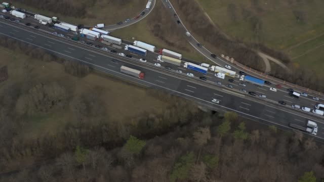 Aerial of Autobahn A8 close to Karlsruhe Aerial of Autobahn A8 close to Karlsruhe with pan over long traffic jam. autobahn stock videos & royalty-free footage