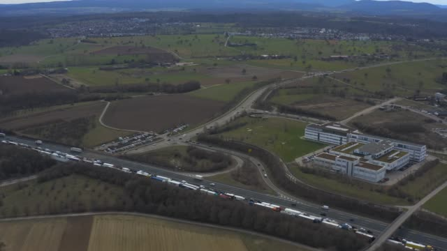Aerial of Autobahn A8 close to Karlsruhe Aerial of Autobahn A8 close to Karlsruhe with traffic jam flying forward. autobahn stock videos & royalty-free footage