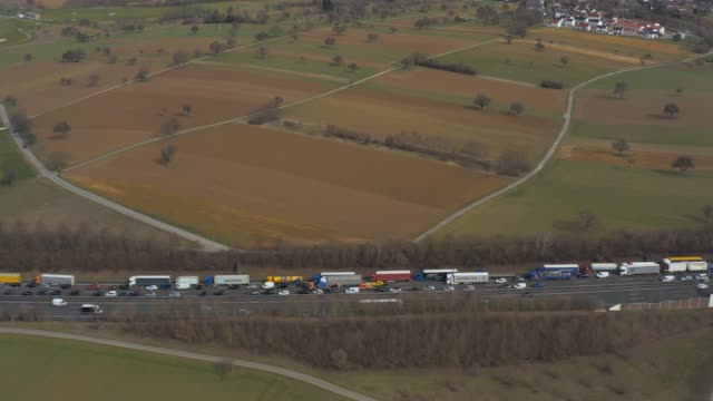 Aerial of Autobahn A8 close to Karlsruhe Aerial of Autobahn A8 close to Karlsruhe with traffic jam and  pan to the left autobahn stock videos & royalty-free footage